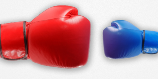 Two boxing gloves juxtaposed; one red and one blue